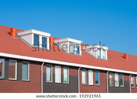newly build terraced houses with dormer windows - stock photo