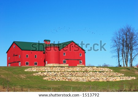 Newly built and landscaped Amish barn - stock photo