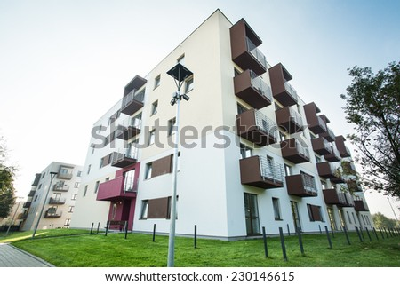 Newly built apartment house at new subdivision - stock photo
