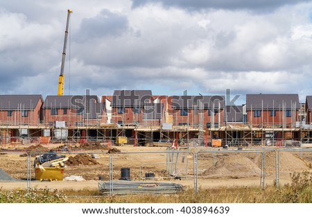 Newly built homes in a residential estate in England.                                 - stock photo