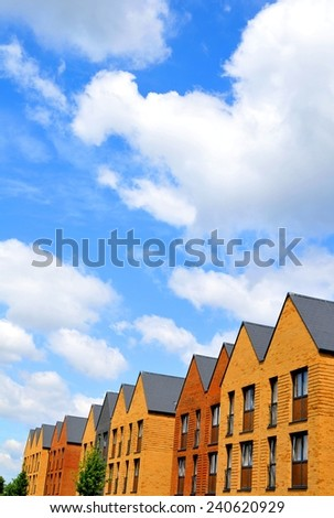Newly built houses against blue sky - stock photo