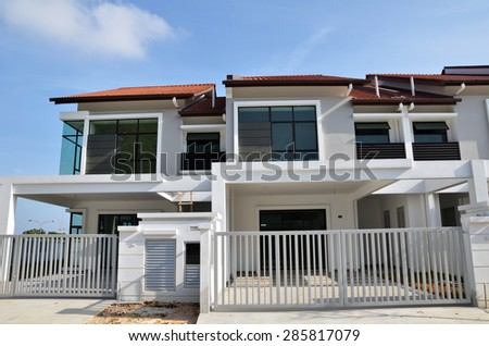 Newly built terrace house under the blue skies - stock photo