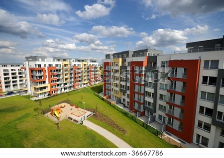 Newly bulit block of flats with blue sky - stock photo