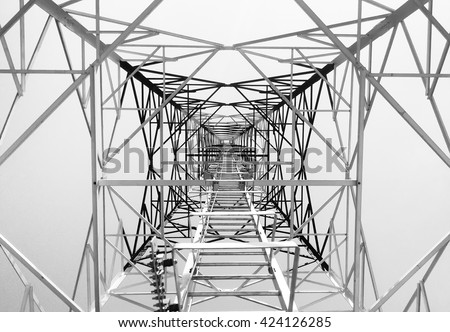 Newly completed telecommunication tower with white and red paint, step ladder in black and white format - stock photo