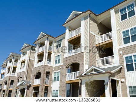 Newly completed typical apartment building - stock photo