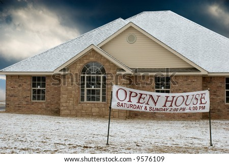 Newly constructed home with open house sign in front - stock photo