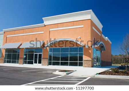 newly constructed retail store with arched awning - stock photo