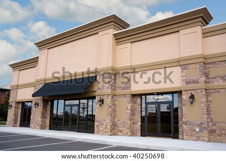 Newly constructed retail storefront - stock photo