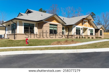 Newly constructed small suburban building - stock photo