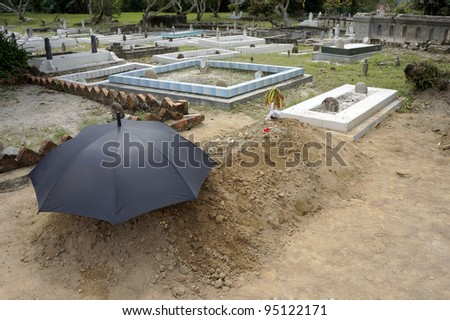 Newly dig grave at the Muslim cemetery. - stock photo