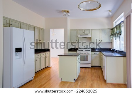 newly finished kitchen wood cabinet and hardwood floor granite counter top - stock photo