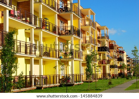 newly  inhabited yellow block of flats and apartments  - stock photo