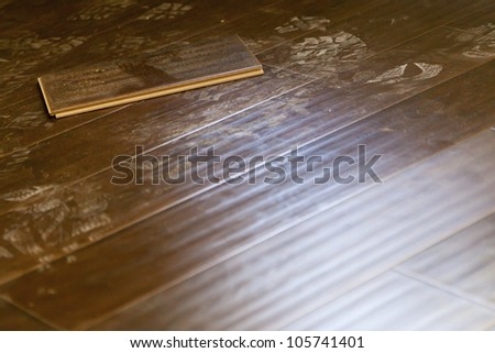 Newly Installed Dusty Brown Laminate Flooring Abstract. - stock photo
