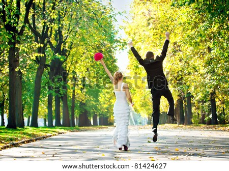 Newly-married couple a back in park. - stock photo