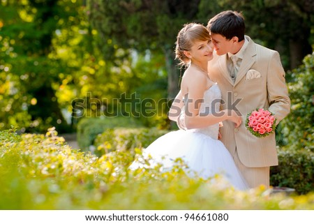 newly married couple in the park - stock photo