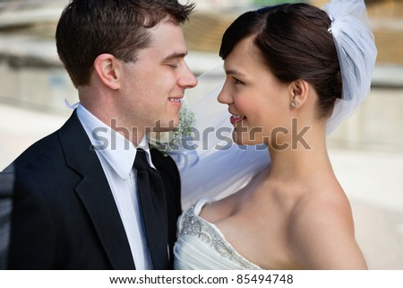 Newly married couple looking at each other - stock photo