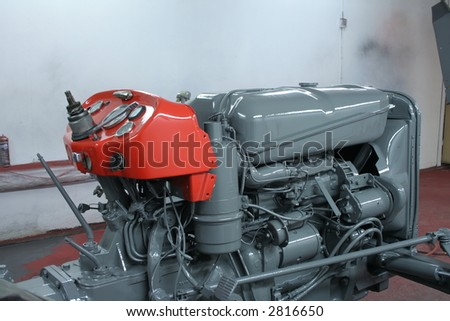 Newly painted tractor - stock photo