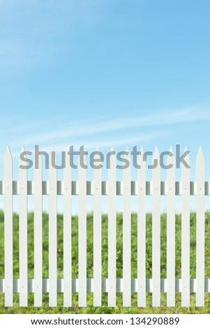 Newly painted white picket fence on a sunny day