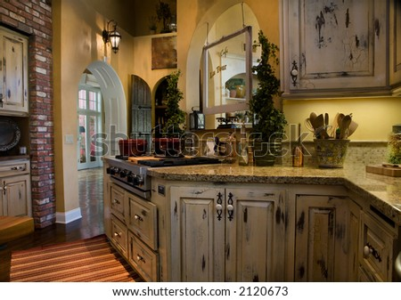 Newly remodeled kitchen with old world style - stock photo