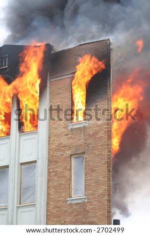 Newly renovated apartment in flames in Detroit - stock photo
