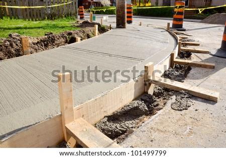newly upgraded sidewalk in residential neighborhood - stock photo