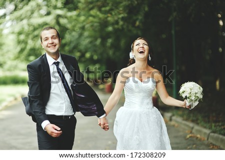 Newly wed couple going crazy. Groom and bride together. - stock photo