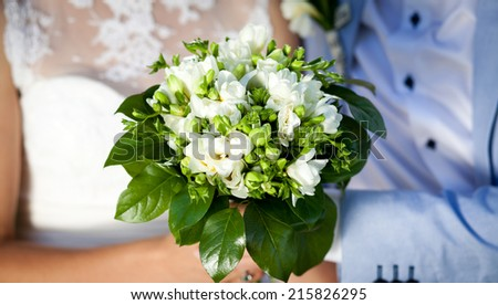 Newly wed couple holding bouquet