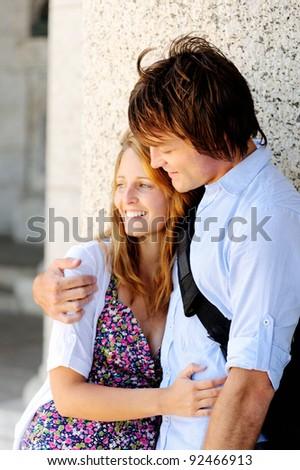 Newly wed couple hugs - stock photo