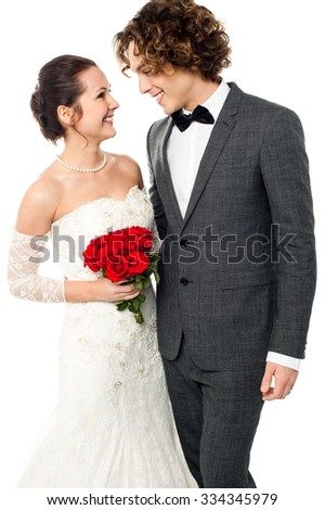 Newly wed couple lost in each other - stock photo