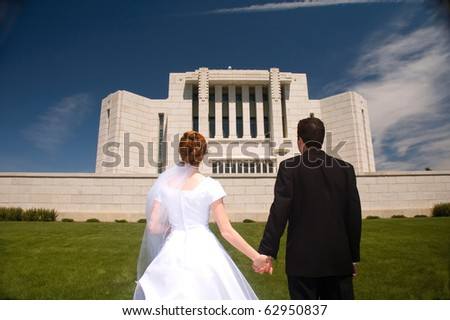 Newly weds holding hands. - stock photo