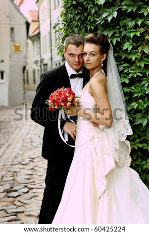 newly-weds in old city - stock photo