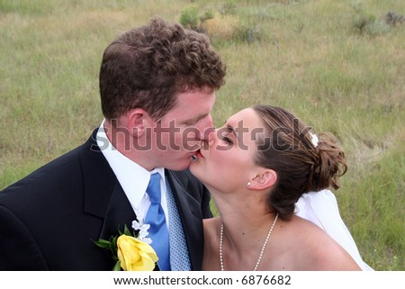 Newly weds moving in for a kiss
