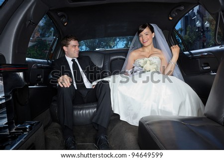 Newlywed in a luxury wedding limousine - stock photo