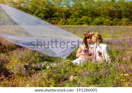 newlyweds in love admire the friend the friend outdoors - stock photo