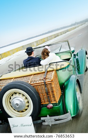 Newlyweds In Wedding Car - stock photo