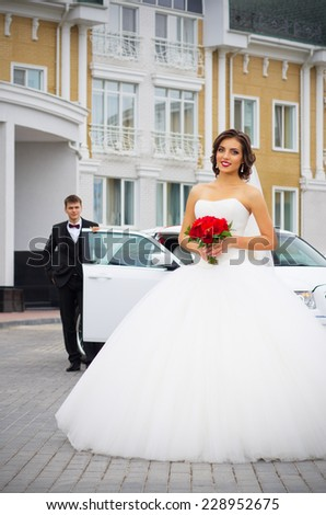 Newlyweds near the old house - stock photo
