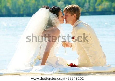 newlyweds on the beach in the summer