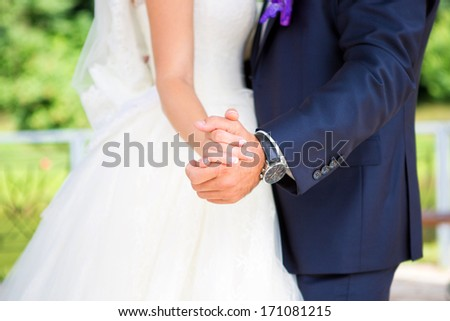 Newlyweds spinning in his first dance. They tenderly embrace each other and forget about saturated wedding day spinning in dance. - stock photo