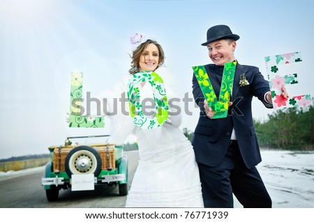 Newlyweds. the newly married couple with word LOVE - stock photo
