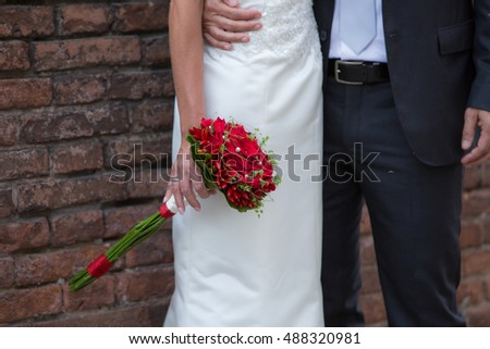 Newlyweds with bouquet