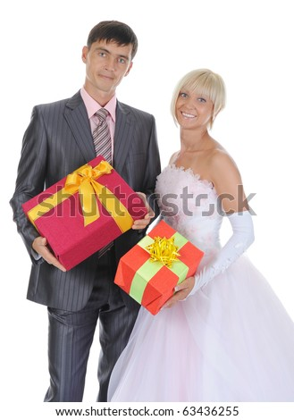 Newlyweds with gift boxes in their hands. Isolated on white background - stock photo