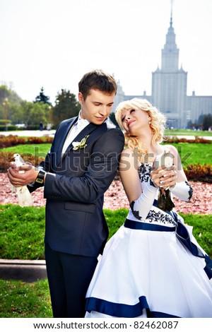 Newlyweds with pigeons on the wedding walk - stock photo