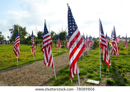 NEWPORT BEACH, CA - MAY 22: 1776 United States flags were flown in honor of all military, law enforcement, fire and first responders at Castaways Park on May 22, 2011 in Newport Beach, California. - stock photo
