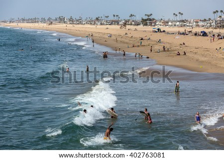 Newport Beach, California, USA - March 20, 2014: tourists and local residents  gather in the sunshine on the beach - stock photo
