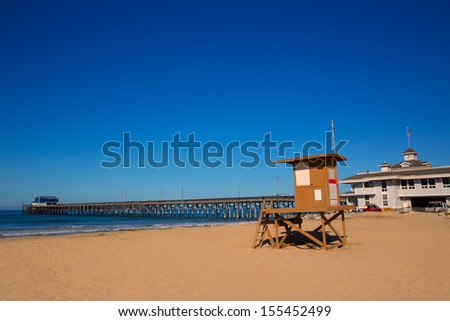 Newport pier beach with lifeguard tower in California USA