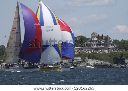 NEWPORT, RI - JUNE 15: Downwind spinnaker start during start of Newport to Bermuda Race in front of Castle Hill  in Newport, RI on June 15, 2012. - stock photo