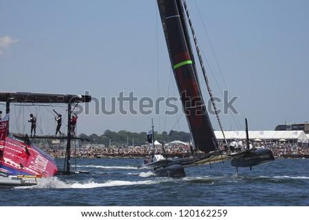 NEWPORT, RI - JUNE 28:  Team New Zealand capsizes during 2012 America's Cup World Seriess in Newport, RI on June 28, 2012. - stock photo