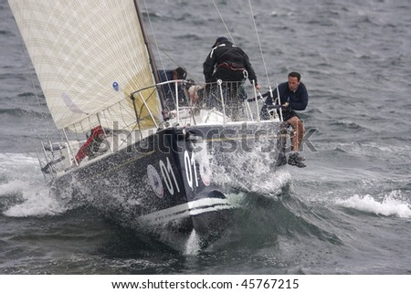 NEWPORT, RI - SEPT 16: The Great Britain's Royal Ocean Racing Club rides a wave in a Swan 42 during the New York Yacht Club Invitational Cup in Newport, RI September 16, 2009.