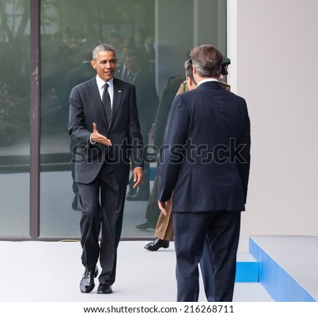 NEWPORT, WALES, UK - Sep 4, 2014:  US President Barack Obama, British Prime Minister David Cameron and NATO Secretary General Anders Fogh Rasmussen at the NATO summit in Newport (Wales, UK) - stock photo