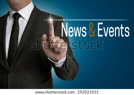 News and Events touchscreen is operated by businessman. - stock photo